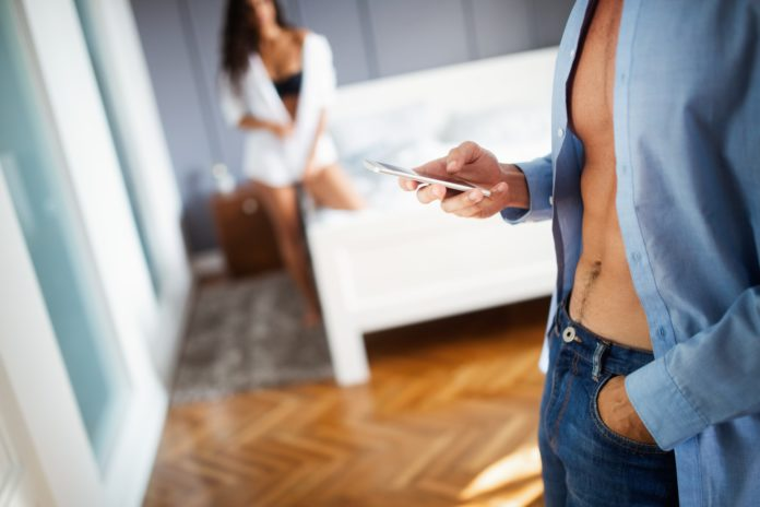 Beautiful woman discovering his boyfriend, husband cheating on the mobile phone